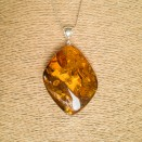 Cognac color amber pendant with a twist #08