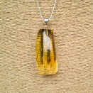 Fragmented green amber pendant