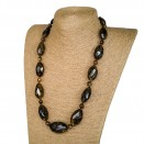 L dark faceted oval long statement