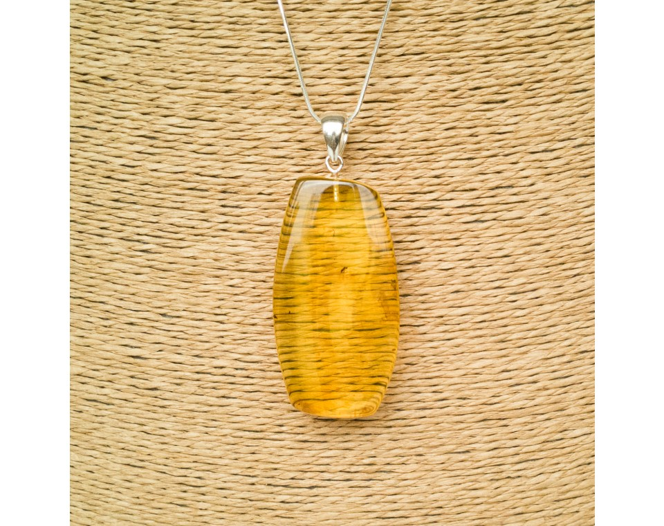 Amber pendant with inclussions #16