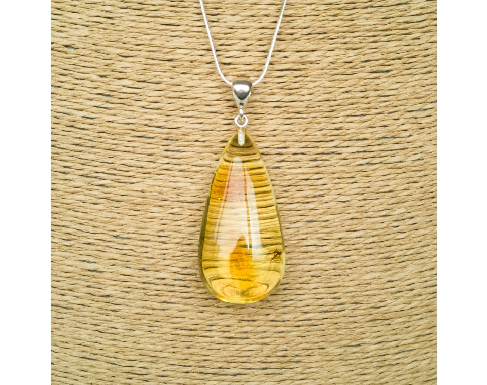 Amber pendant with inclussions #20