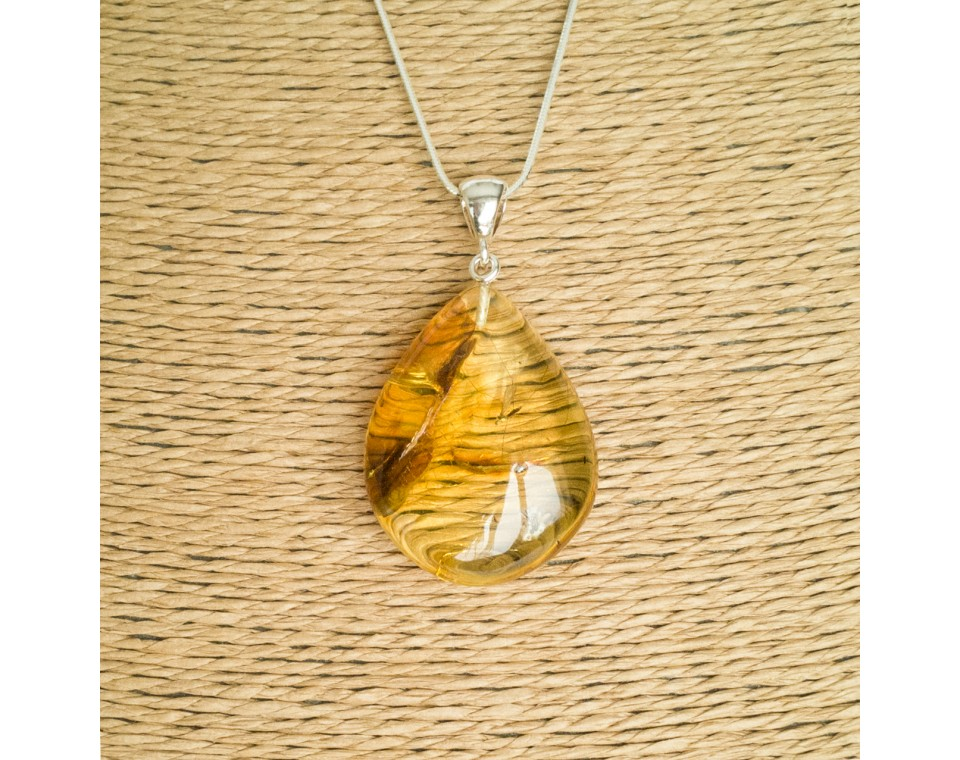 Amber pendant with inclussions #21