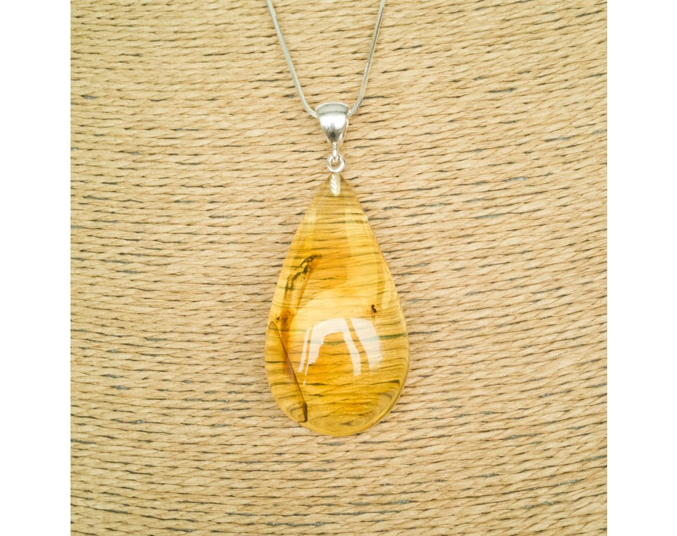 Amber pendant with inclussions #27