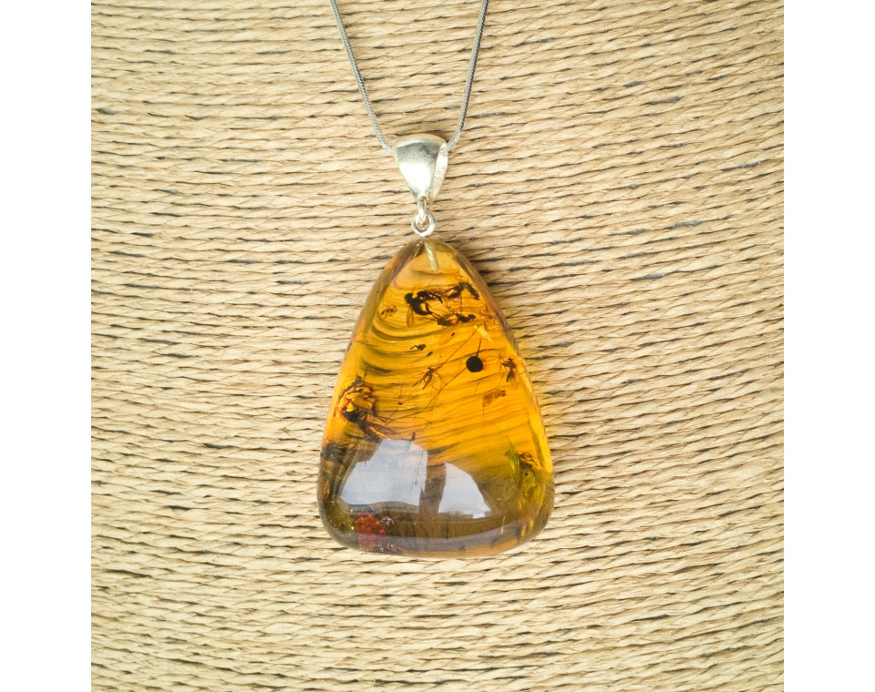 Amber pendant with inclussions #33