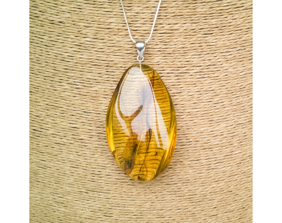 Cognac color amber pendant with a twist #07