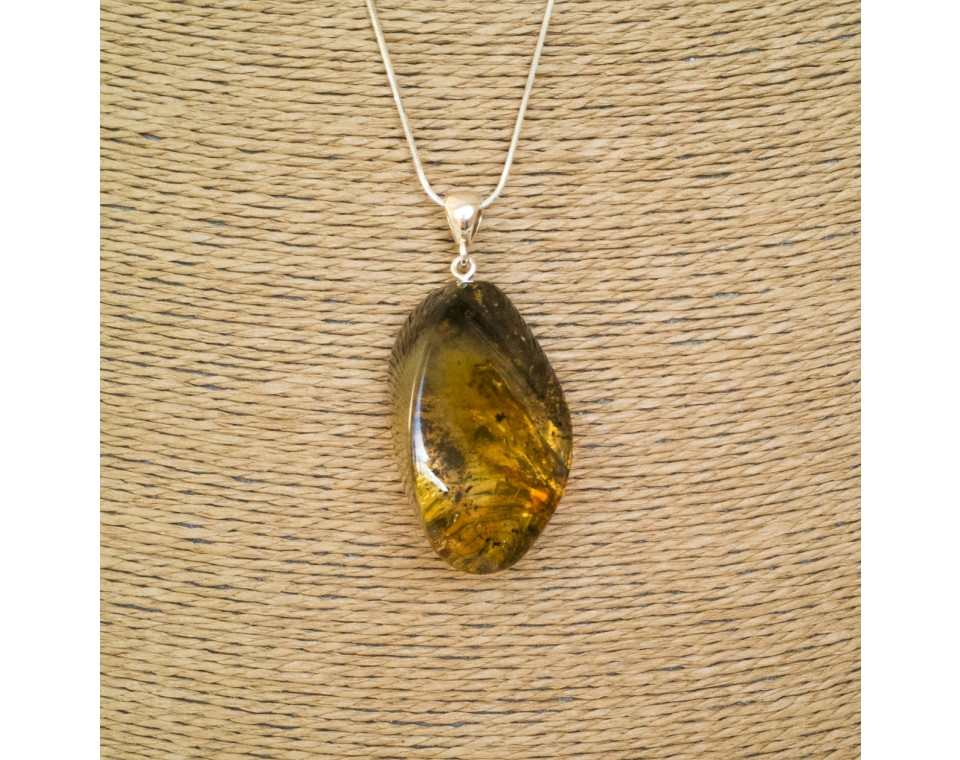 Green amber pendant with a twist #03