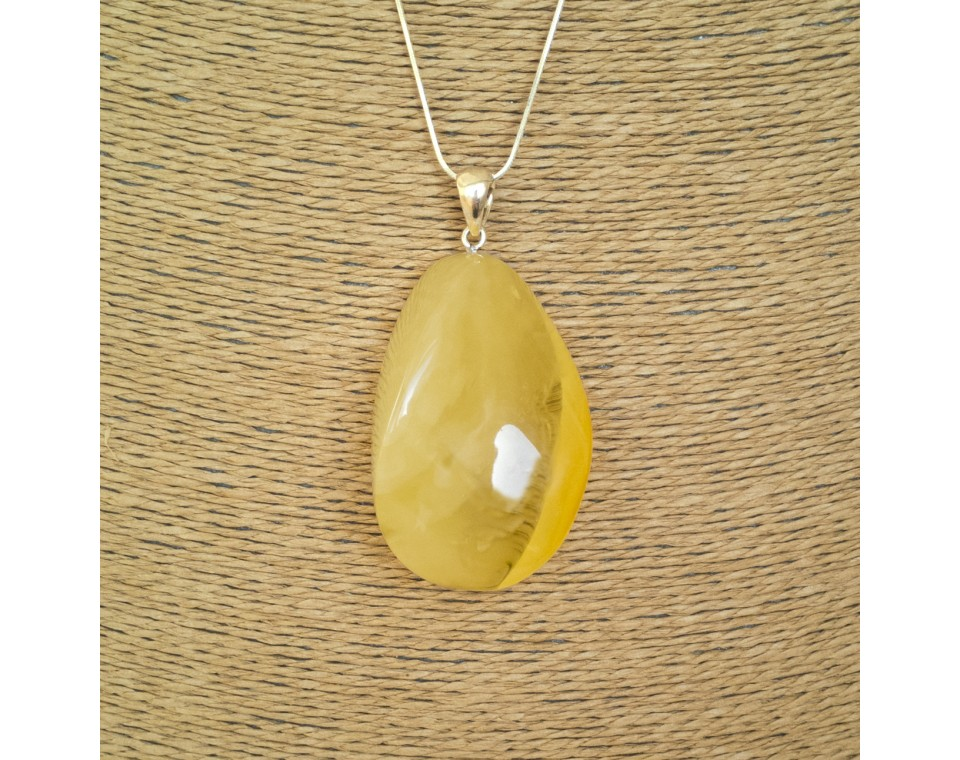 Matt color amber pendant with a twist #01