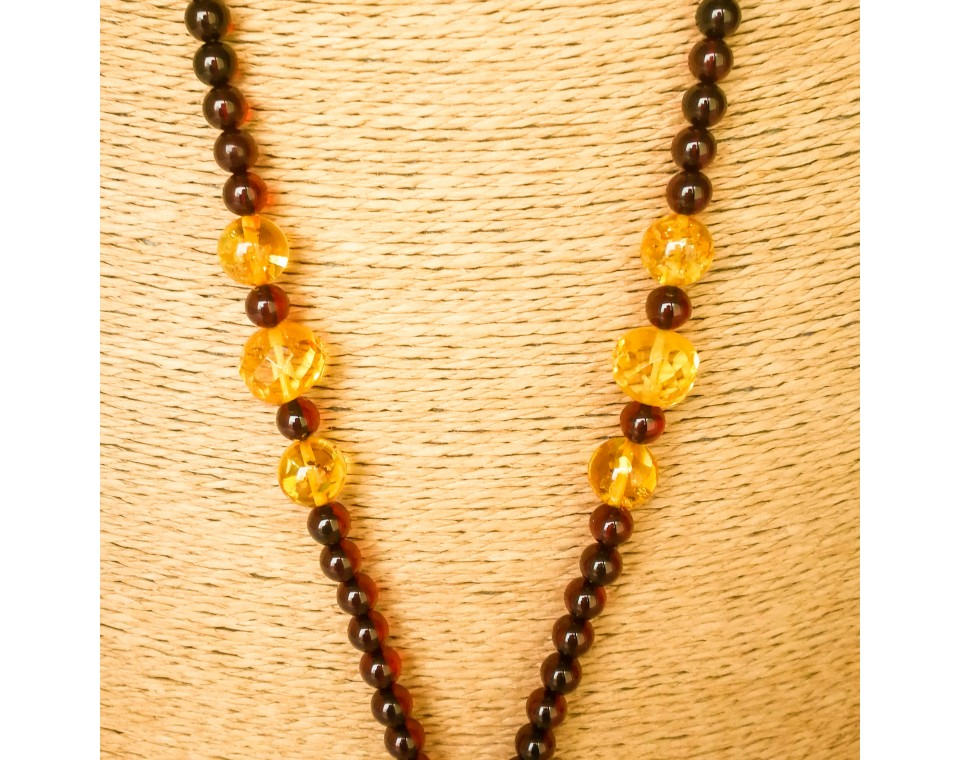 Round cherry color beads and twisted yellow pendant necklace