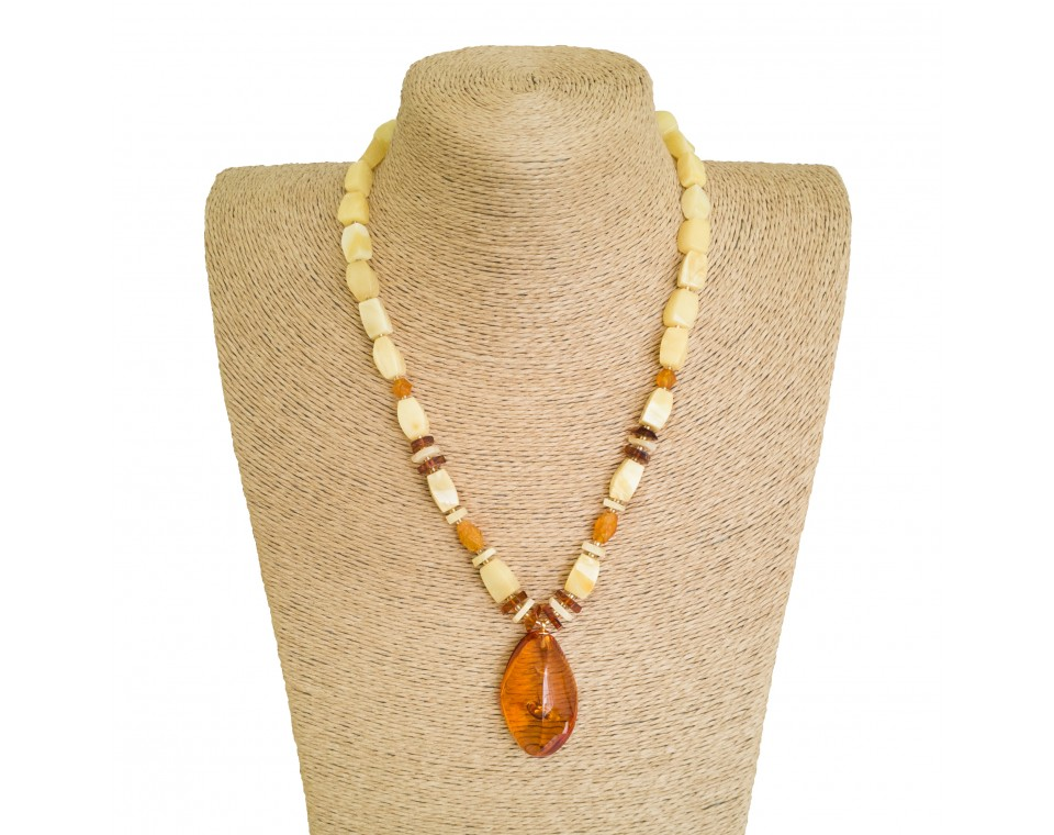 Twisted natural amber cognac color pendant with white rectangle beads necklace