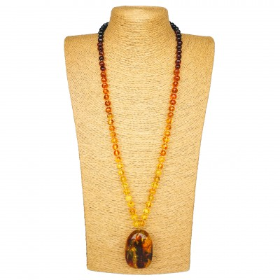 Natural shape cognac color amber pendant on rainbow necklace